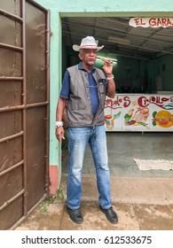 Trinidad, Cuba - January 12, 2017: Local man smoking a cigar in the streets of Trinidad, Cuba.