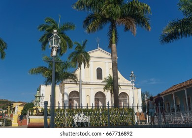 Trinidad, Cuba, January 3, 2017:  Central park view with colonial church. Trinidad is one of the most important touristic places in Cuba