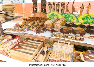 TRINIDAD, CUBA - JANUARY 4, 2017: Cuban national flags, cigars, boxes, Che Guevera portraits and other  souvenirs typical for Cuba sold in souvenir shop in street market in Trinidad, Cuba