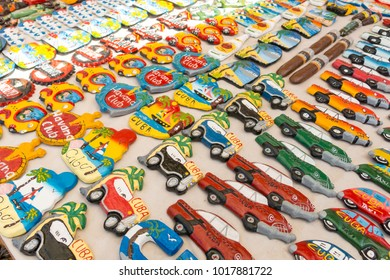 TRINIDAD, CUBA - JANUARY 4, 2017: Cuban national flags, palm, Che Guevera portraits and other fridge magnet / souvenirs typical for Cuba sold in souvenir shop in street market in Trinidad, Cuba