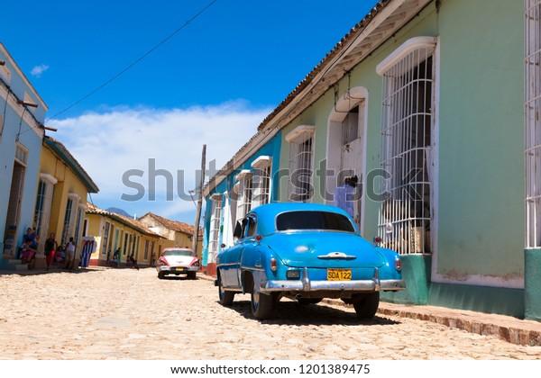 TRINIDAD, CUBA - MARCH 12, 2013: Blue retro  cars auto in town Trinidad in Cuba.