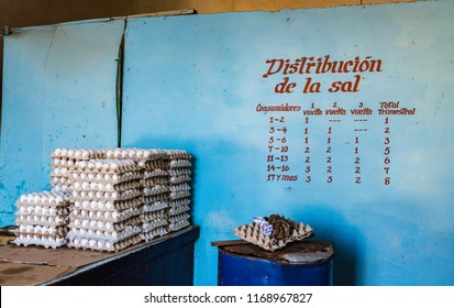 Trinidad /Cuba - March 15, 2016: Stacks of egg cartons and salt distribution quotas in Cuba where ration cards are used to limit purchase of goods at government run grocery stores.