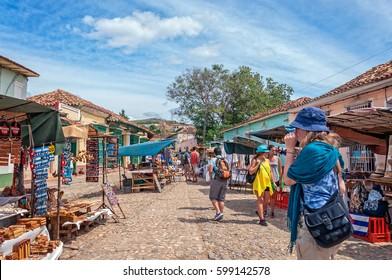 Trinidad, Cuba -March 8, 2016: Souvenir market on a cobblestone street in Trinidad, Cuba.