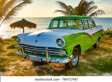 Trinidad, Cuba, Nov 28, 2017 - Green and white 1950's Class America  Ford Fairlane parked on beach