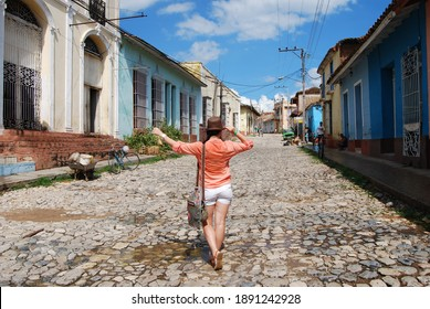 Trinidad, Cuba, September 15, 2017: Girl walking down the street of the old town