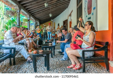 Trinidad, Cuba-July 9, 2018: Tourists drinking in a famous bar in the Unesco World  Heritage village. The place is a major tourist attraction