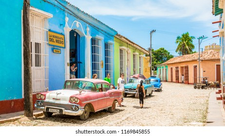 Trinidad, Cuba-July 9, 2018: Vintage car parked in front of a famous restaurant in the colonial village. Trinidad is a Unesco World Heritage Site