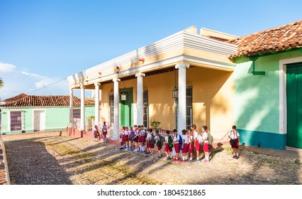 Trinidad, Cuba-October 14, 2016. Group of the young school children, Cuban pioneers, walks at The Plaza Mayor on October 14, 2016 in colonial town Trinidad.