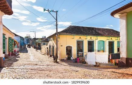 Trinidad, Cuba-October 14, 2016. View of the street with colorful historical colonial style buildings and every day life of cuban people on October 14, 2016 in Trinidad town of central Cuba.