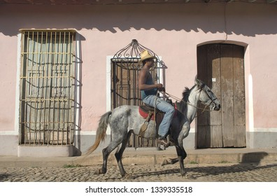 TRINIDAD, CUBA-SEPTEMBER 27,2016: Local on horse in a street of the old colonial town of Trinidad, Cuba