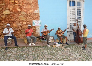 Trinidad - July 27: musicians play in the street in Trinidad, Cuba on July 27, 2014. Cuban music is popular throughout the world and is influenced by West African and Spanish music.