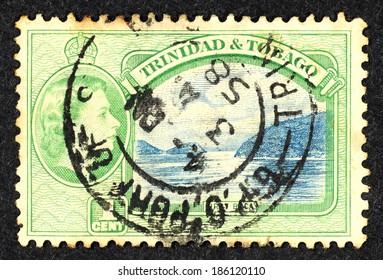 TRINIDAD & TOBAGO - CIRCA 1958: Green color postage stamp printed in Trinidad & Tobago with landscape image of First Boca.