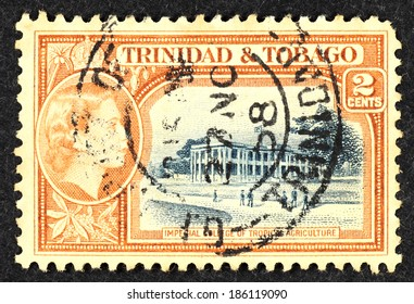 TRINIDAD & TOBAGO - CIRCA 1958: Orange color postage stamp printed in Trinidad & Tobago with image of the Imperial College of Tropical Agriculture building.