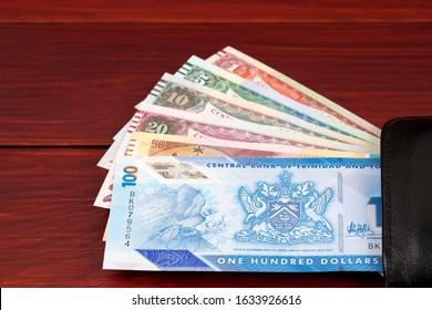 Trinidad and Tobago dollar in the black wallet