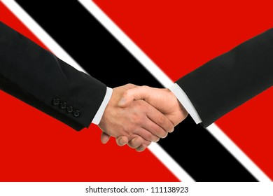 The Trinidad and Tobago flag and business handshake