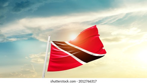 Trinidad and Tobago national flag waving in beautiful clouds.