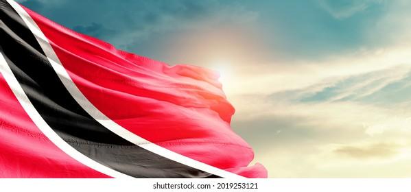 Trinidad and Tobago national flag waving in beautiful sky.