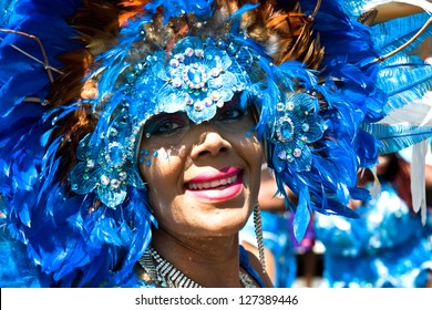 TRINIDAD WEST INDIES - FEB 5, 2008: smiling female masquerader with headdress taking part in Carnival Tuesday celebrations on February 5, 2008 in Port Of Spain, Trinidad W.I.