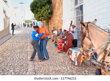 TRINIDAD,CUBA-JANUARY 12:Unidentified couple dance salsa on January 12, 2010.Trinidad,Cuba.Employment options in Cuba are very slim, street salsa bands are very common and mostly entertain tourists