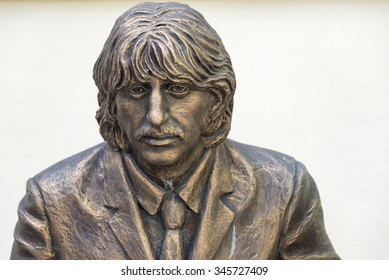 TRINIDAD,CUBA-JULY 5,2015:Trinidad de Cuba tourism: Statue honoring the Beatles built at the Music House. Trinidad is one of the oldest villages founded by Spanish and a UNESCO World Heritage Site