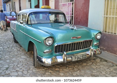 TRINIDAT, CUBA - January 8, 2018: Vintage taxi car parked on the street.