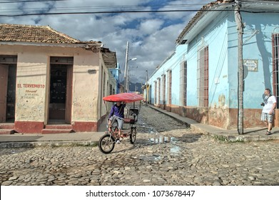 TRINIDAT, CUBA - January 8, 2018: Cycle rickshaw on the cobblestone streets of the Old Town.