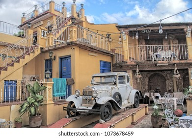 TRINIDAT, CUBA - January 8, 2018: Retro car in the patio of an old restaurant, in a colonial style.
