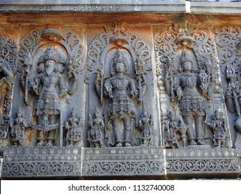 Trinity, Brahma-Vishnu-Mashesha at Hoysaleswara temple / Halebidu temple, Halebidu, Hassan District of Karnataka state, India. The temple was built in 12th-century rule of Hoysala Empire.