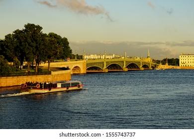 Trinity Bridge (Troitskiy Bridge) in Saint Petersburg with historic buildings and architecture on a beautiful summer day. Saint Petersburg, Russia June 29, 2019.