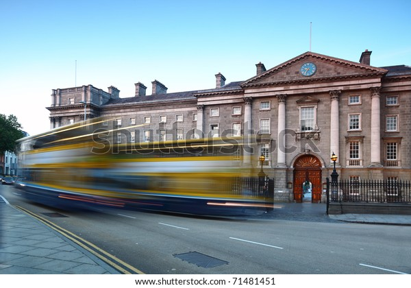 Trinity College at day in Dublin, Ireland. Bus quickly rides on road