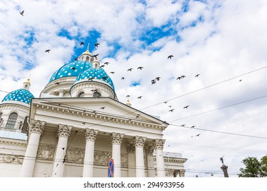 Trinity Izmailovo Cathedral, Saint Petersburg Russia. Fragment of  building with wires and  flying birds