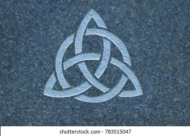 Trinity knot on stone surface