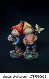 trinket girl and boy decorative. trinket two brothers. two kids trinkets decorative. two kids on a black background