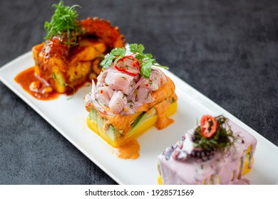 Limeñas trio of causes, olive octopus cause, sweet potato cause with octopus, spicy potato cause with ceviche