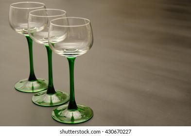 Trio of Classic Green Stemmed Empty Wine Glasses