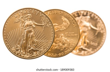 Trio of gold eagle one troy ounce golden coins from US Treasury mint