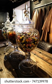 Trio of large glass jars containing liquorice allsorts sweets.