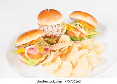 Trio of mini sandwiches with cheese, tuna and turkey ham close up