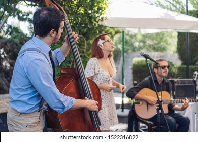 trio playing music on stage outdoor