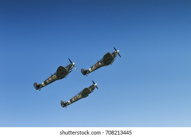 A trio of Supermarine Spitfires climbing on May 27th 2012 at Duxford, Cambridgeshire, UK