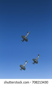 A trio of Supermarine Spitfires diving on May 27th 2012 at Duxford, Cambridgeshire, UK
