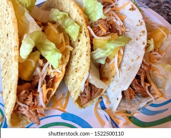 Trio of Yummy Pork and Pineapple Tacos in Soft and Hard Shells on a Plate