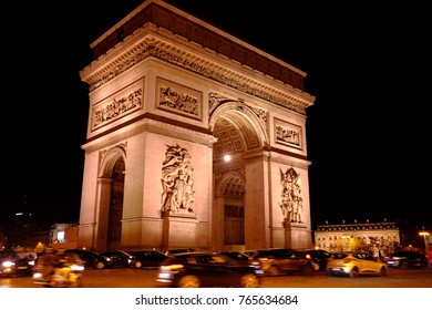 The Triomphal arch of night in Paris, France