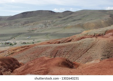 Trip in Altai Mountains. Red Colorful clay.