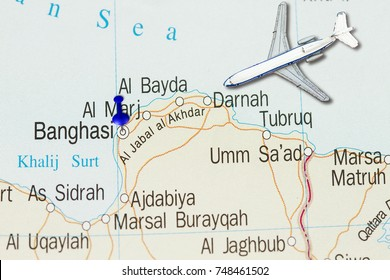Trip to Benghazi with toy airplane and push pin  on map of Japan.