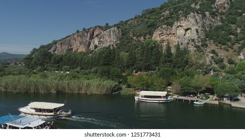 Trip boats in the 'Dalyan' river and view of Kaunos: An Ancient City of Ruins and Rock Cut Tombs/Dalyan region,Mugla-TURKEY
