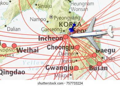 Trip to Korea concept- with map of korea and push pin in the capital city of Seoul.