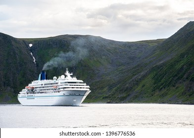 trip to nordkapp, view to a fjord with a boat