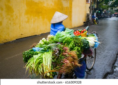 A trip to Vietnam, a woman with vegetables on the streets of Hoi An