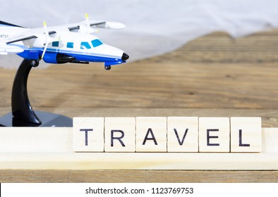 Trip written with words next to an airplane